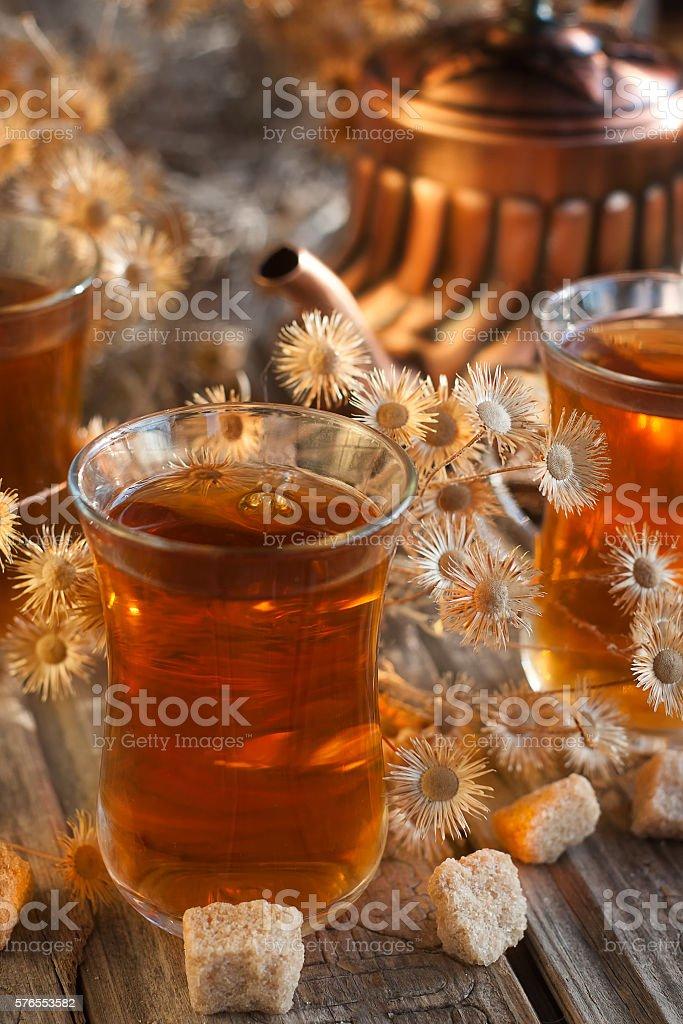 Tea and dry flowers stock photo