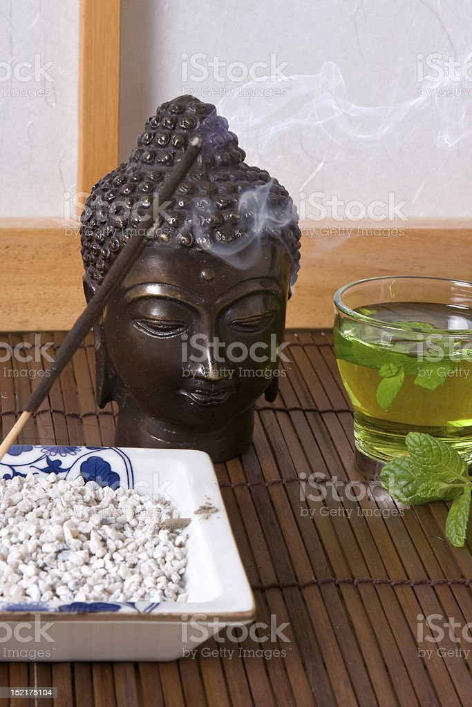 Tea and incense royalty-free stock photo