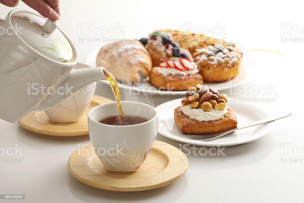 Tea and sweet rolls stock photo