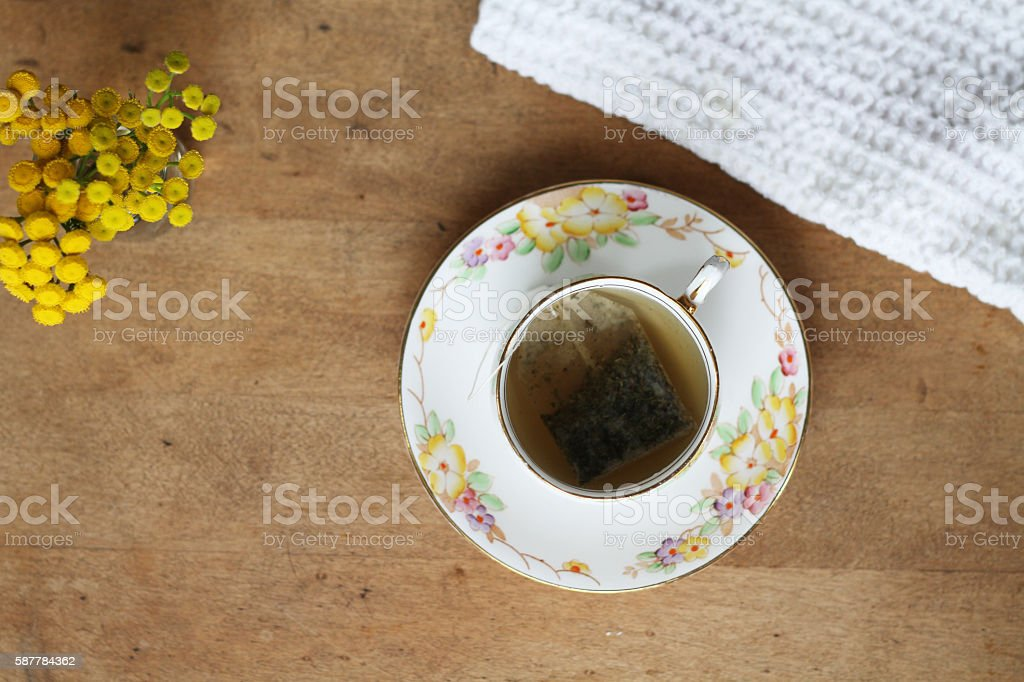 Tea and Yellow Flowers stock photo