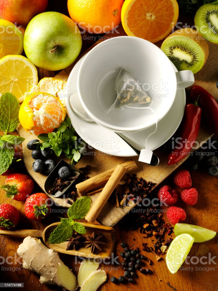 Tea Bag in a Cup Framed by Fresh Fruit royalty-free stock photo
