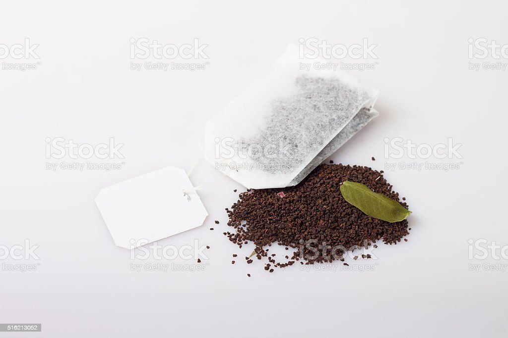 tea bag over dried leafs leaves background stock photo