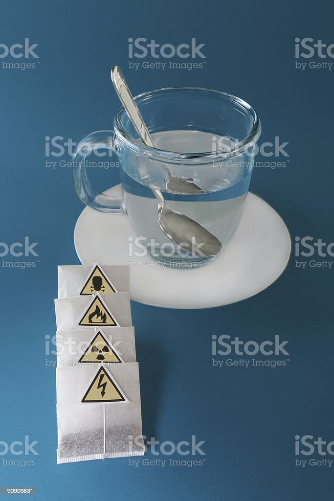 tea bags and glass cup with spoon royalty-free stock photo