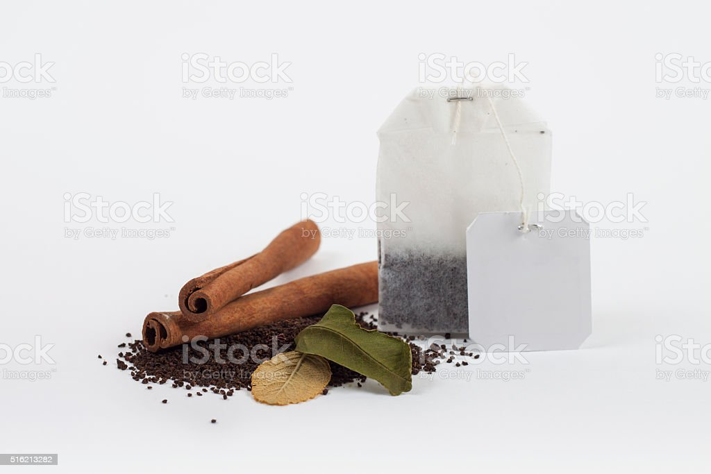 tea bags with dry leaves and cinnamon sticks stock photo