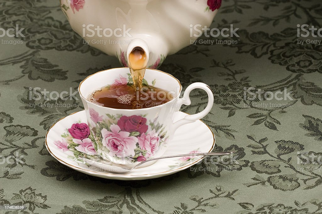 Tea being poured into a cup royalty-free stock photo