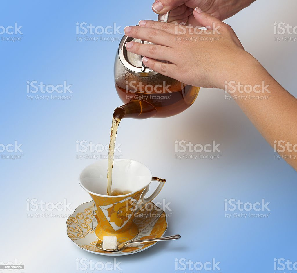 Tea being poured royalty-free stock photo