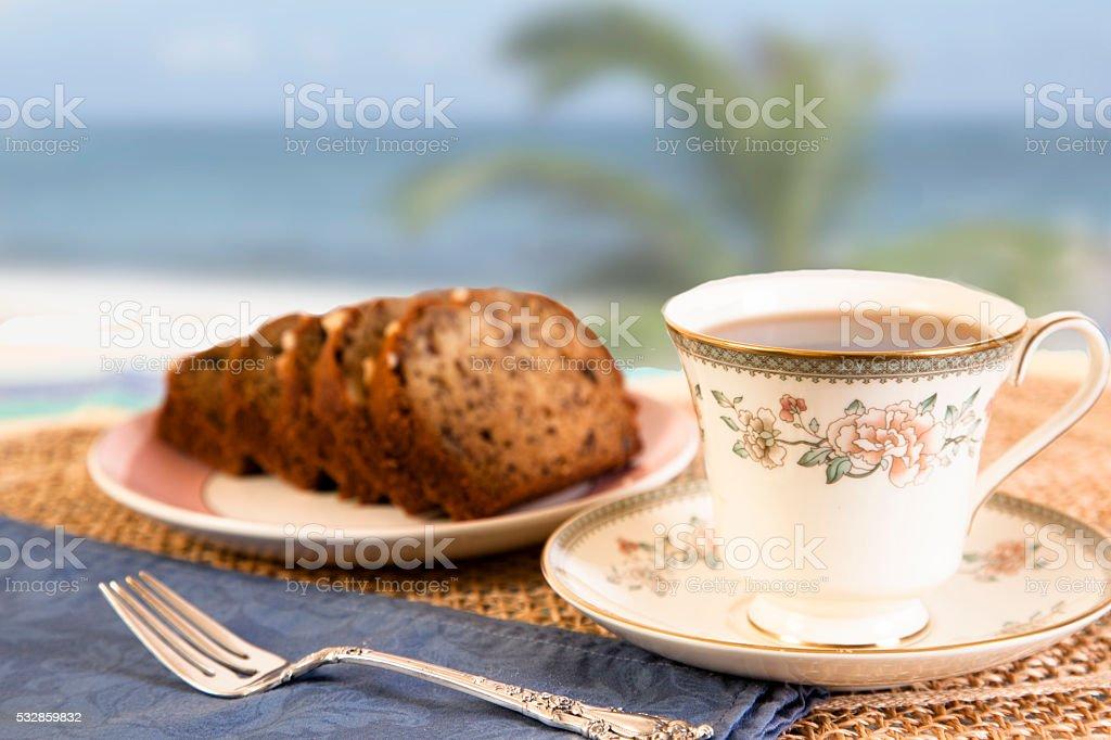 Tea, bread on beach background.  Breakfast. Relaxation. stock photo