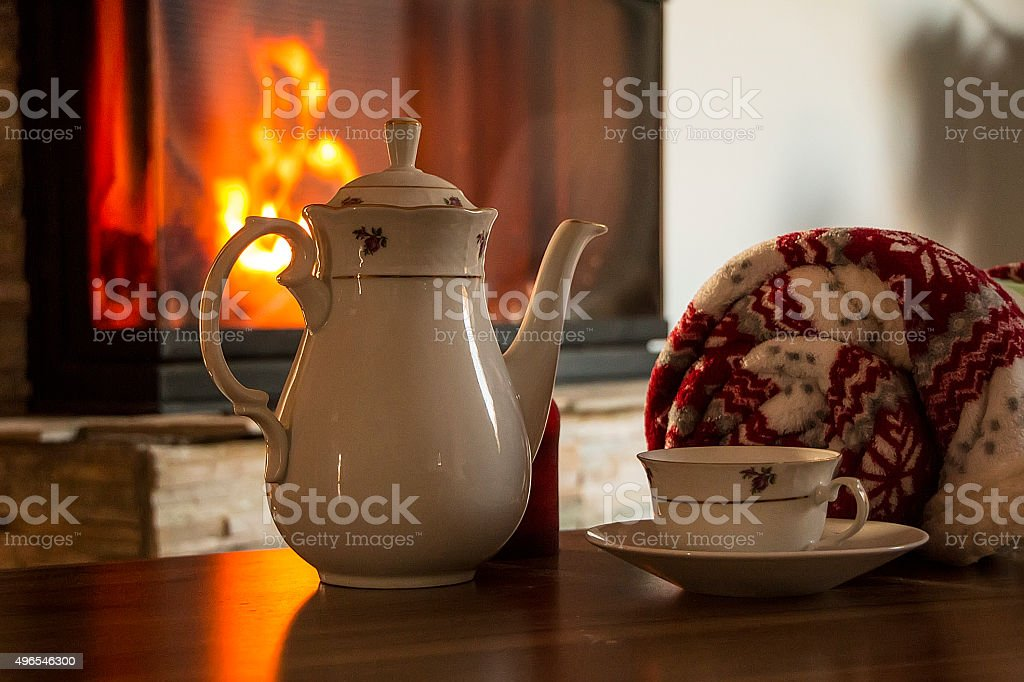Tea by fireplace stock photo