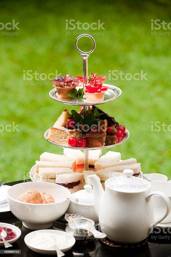 Tea cakes and formal outdoor tea service stock photo