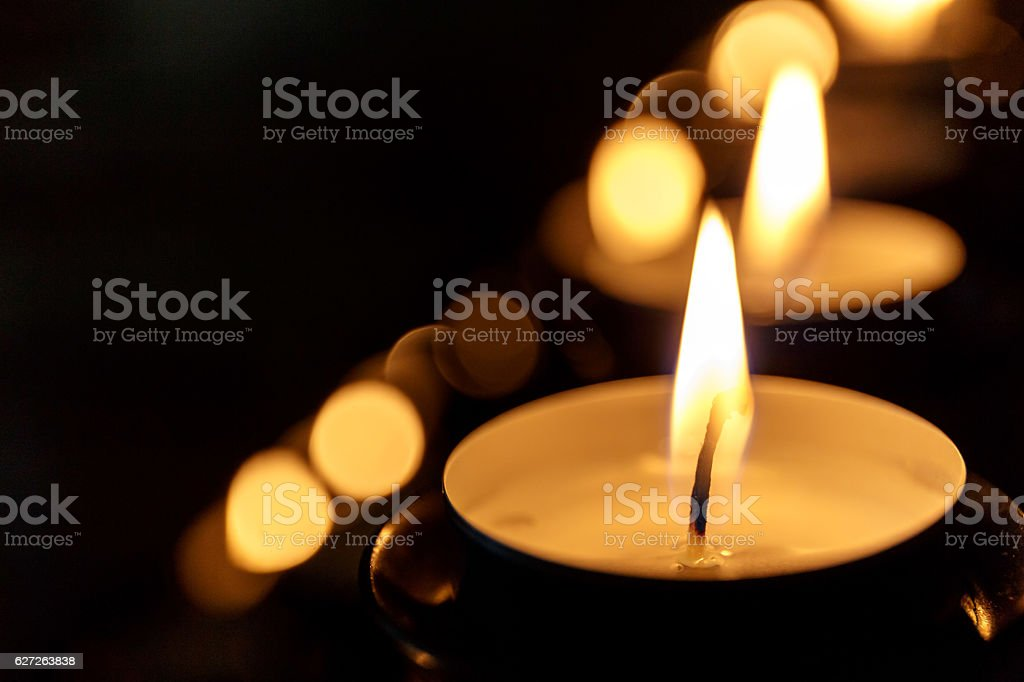 Tea candles in church stock photo