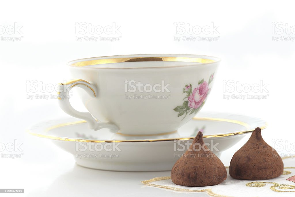 Tea cup and chocolates stock photo