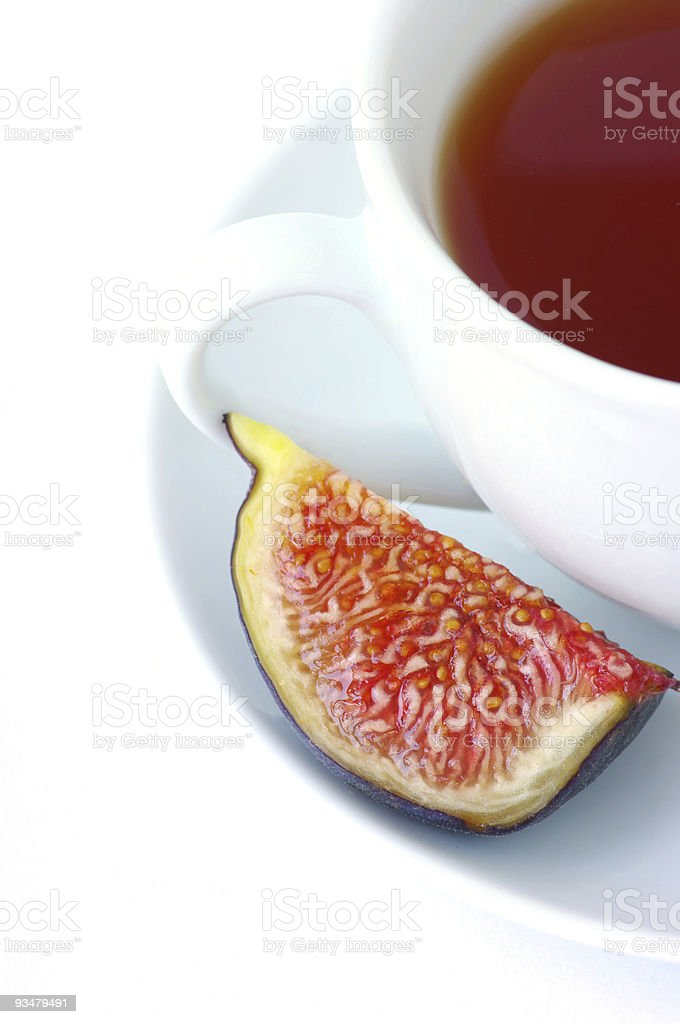 Tea cup and fig fruit royalty-free stock photo