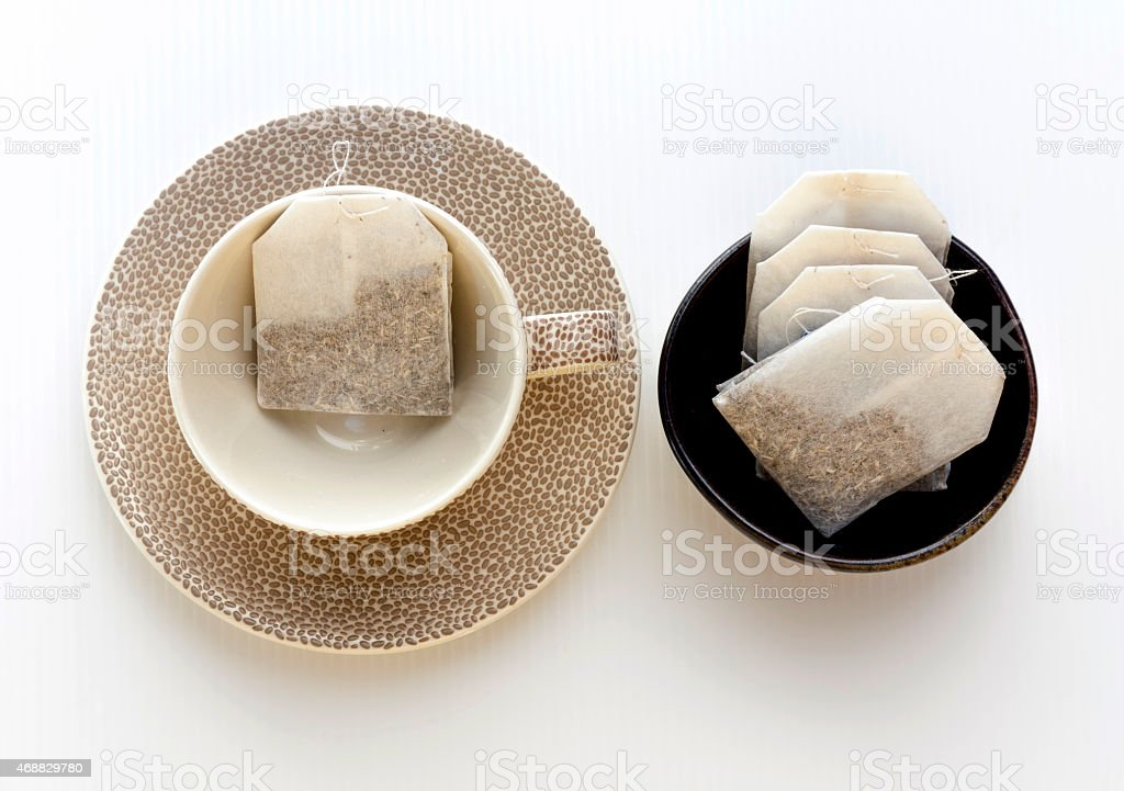 Tea cup and tea bag set with white background royalty-free stock photo