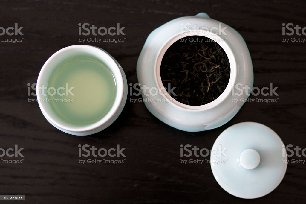 tea cup and tea leaf container stock photo