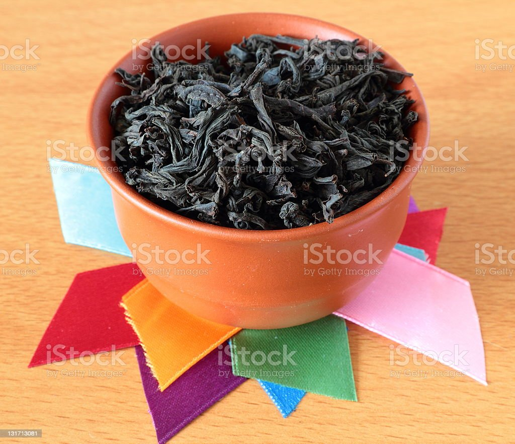 Tea cup, decorated with colorful ribbon. stock photo