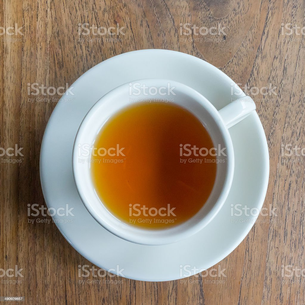 Tea cup on a wood table stock photo