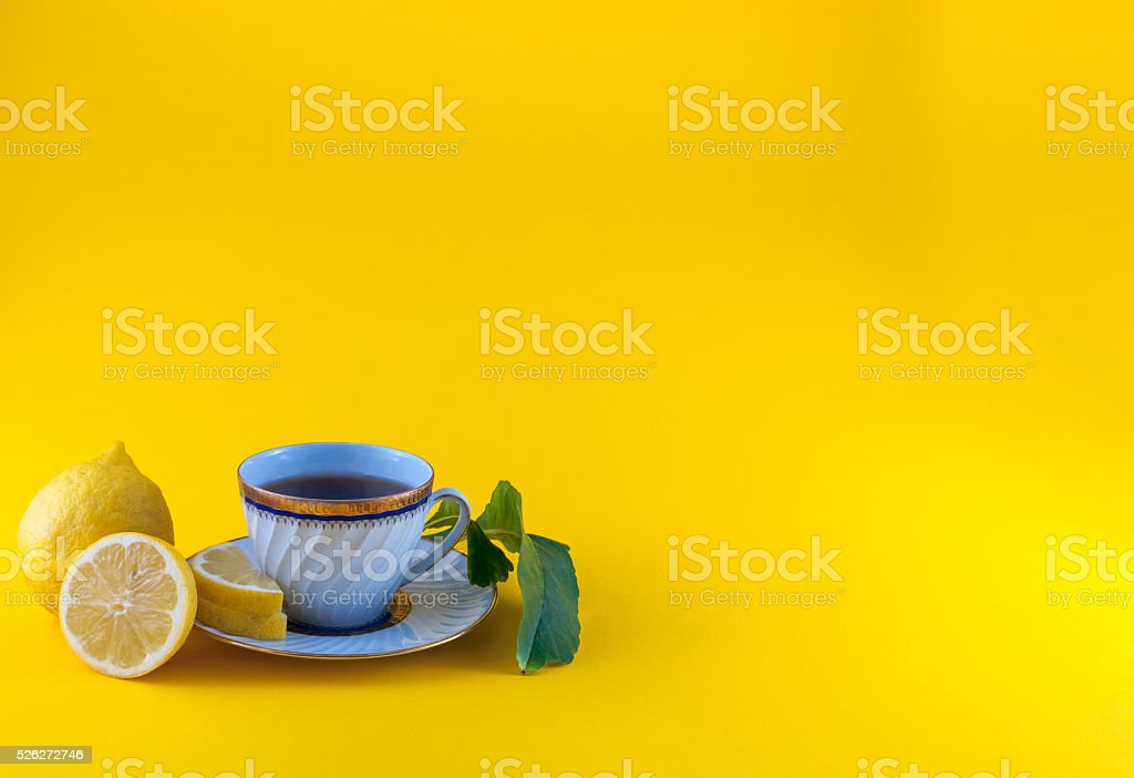 Tea cup on colored background stock photo
