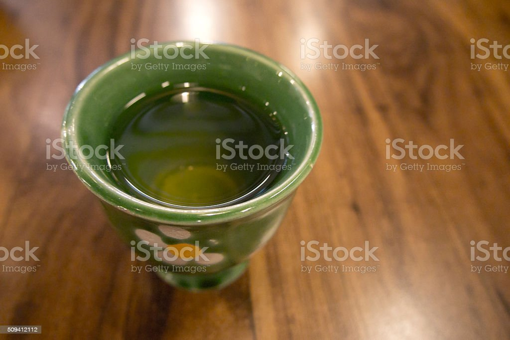 Tea cup on wood table stock photo