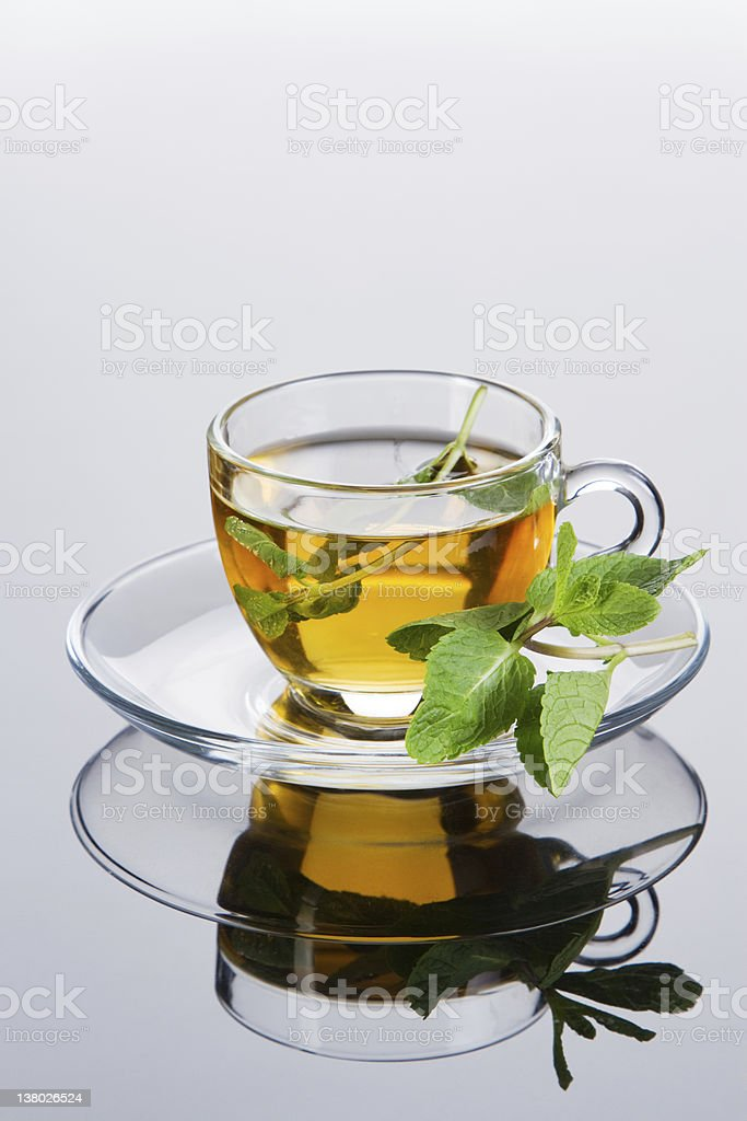 Tea cup with fresh mint leaves royalty-free stock photo