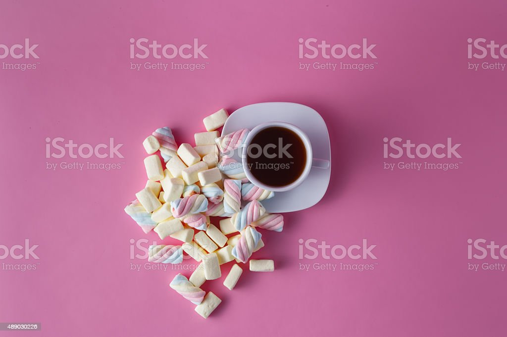 Tea cup with marshmallow stock photo