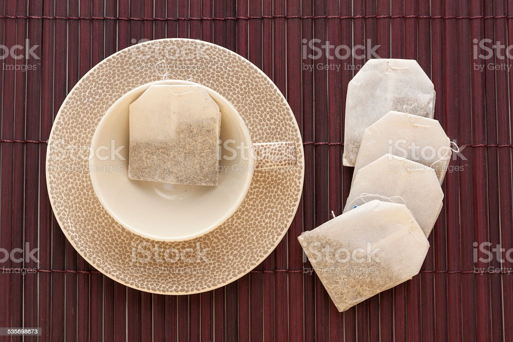 Tea cup with tea bag set with dark background royalty-free stock photo
