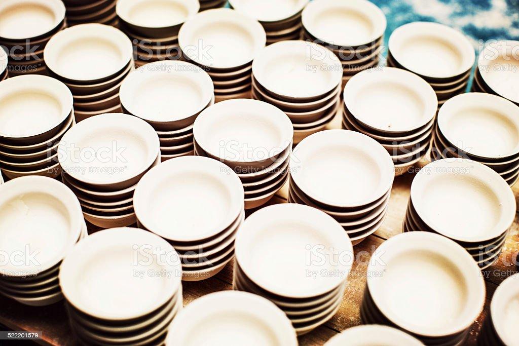 Tea cups awaiting the kiln stock photo