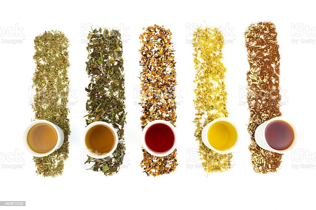 Tea cups with various colorful teas stock photo