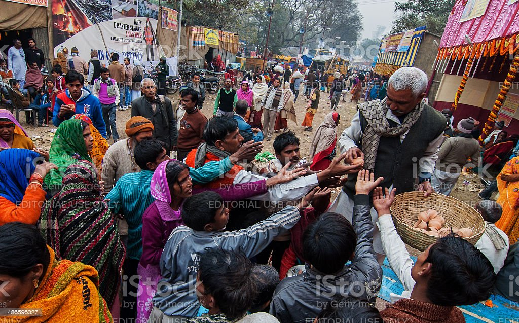 Tea distributed to Hindu devotees at transit camp stock photo