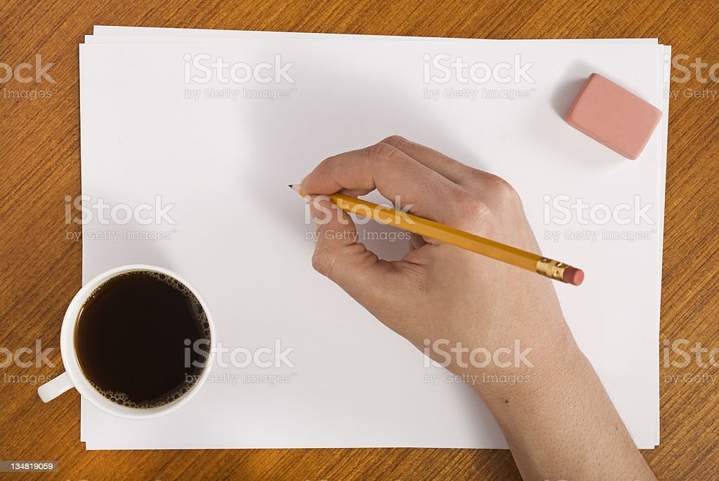 Tea Drinker preparing to write on paper royalty-free stock photo