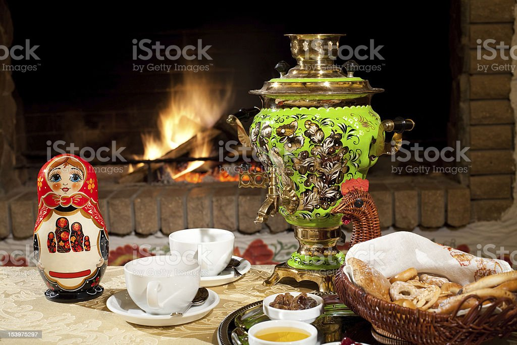 tea drinking at a fireplace stock photo