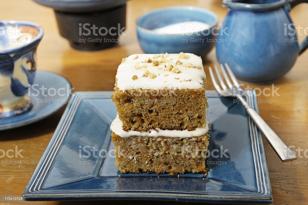 Tea for two with carrot cake portion stock photo