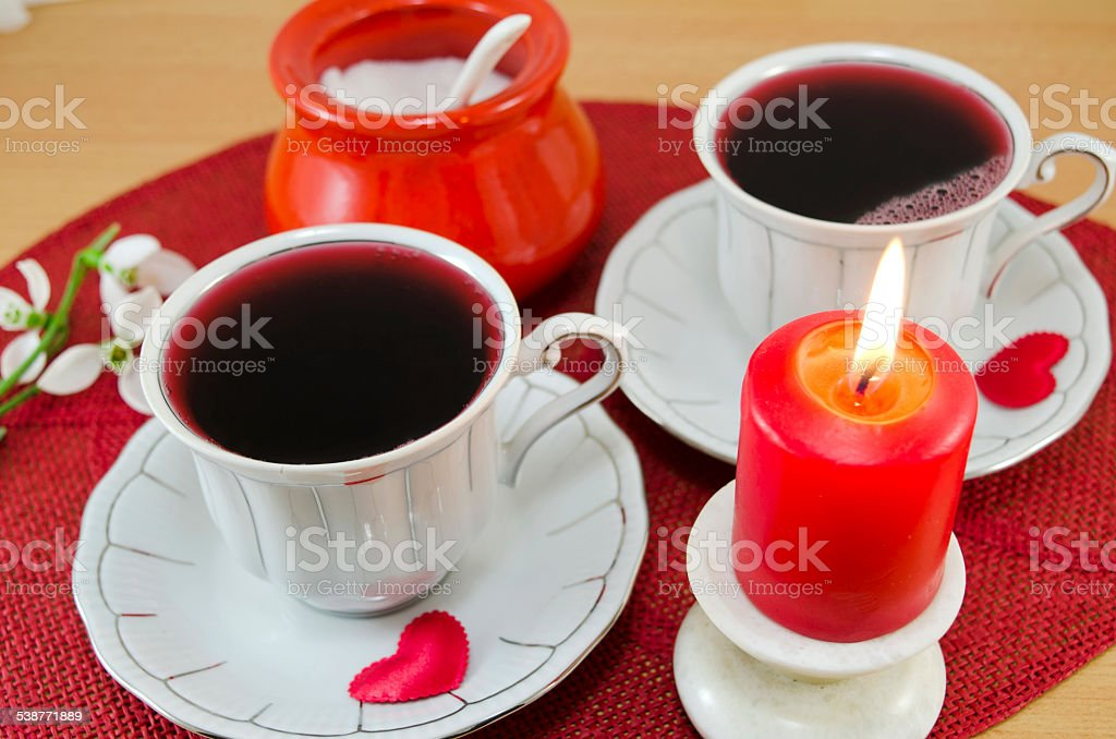 Tea for two with red candle and sugar royalty-free stock photo