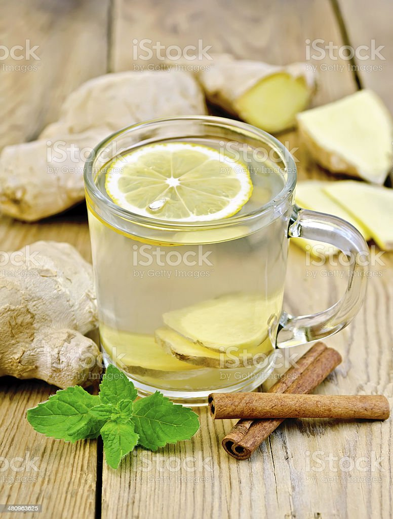 Tea ginger with mint and cinnamon in a mug stock photo