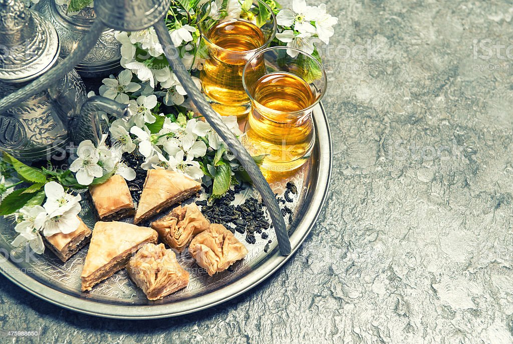 Tea glasses and pot, traditional cookies baklava. Islamic holidays stock photo