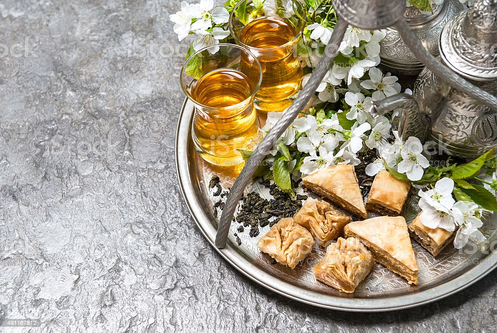 Tea glasses and pot, traditional sweets. Islamic holidays. Eid al-Fitr stock photo