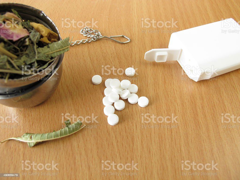 Tea herbs and sweetener tablets stock photo