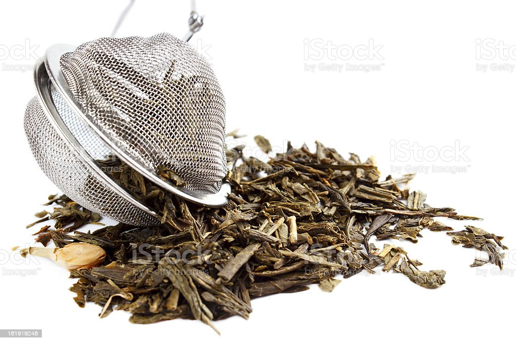 Tea herbs with strainer royalty-free stock photo