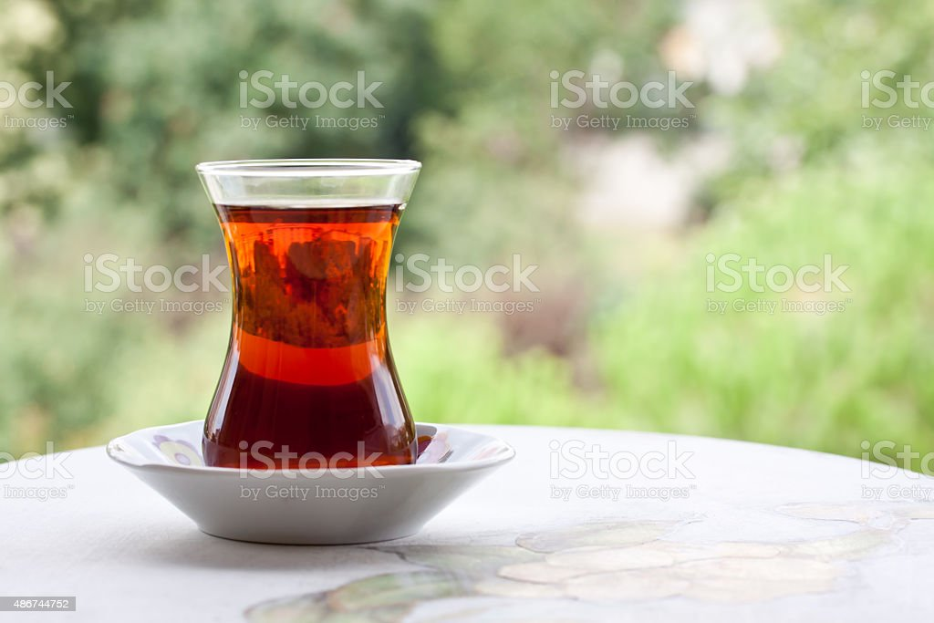 tea in a turkish thin tea glass stock photo