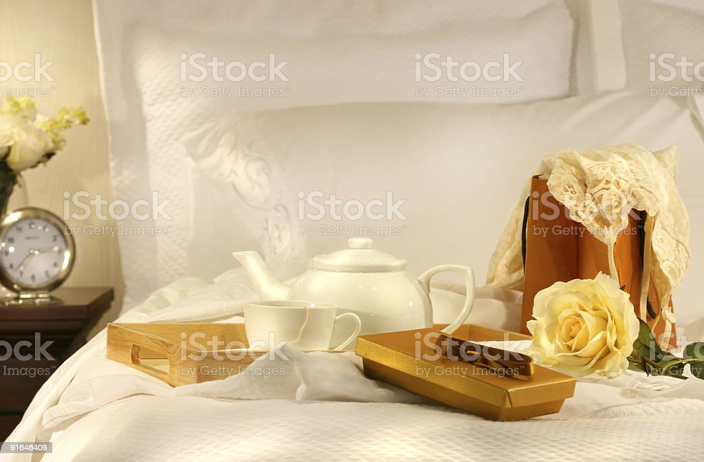 Tea in bed with chocolates stock photo