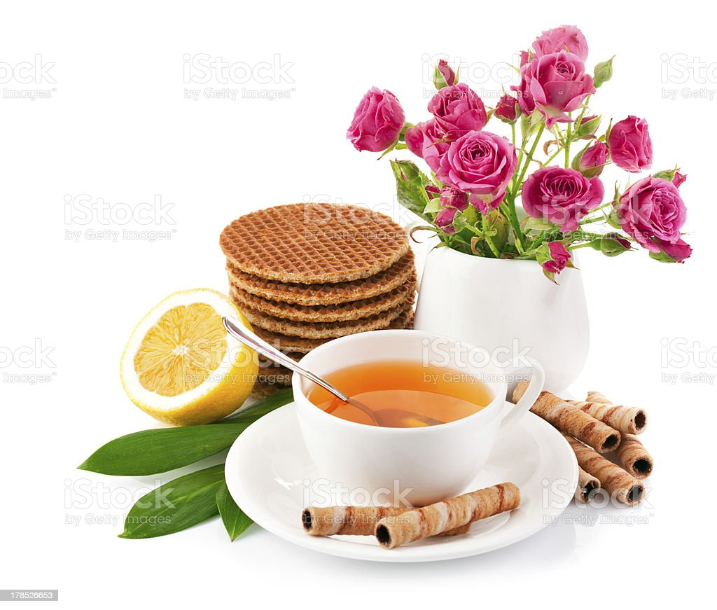 tea in cup with biscuits and lemon royalty-free stock photo