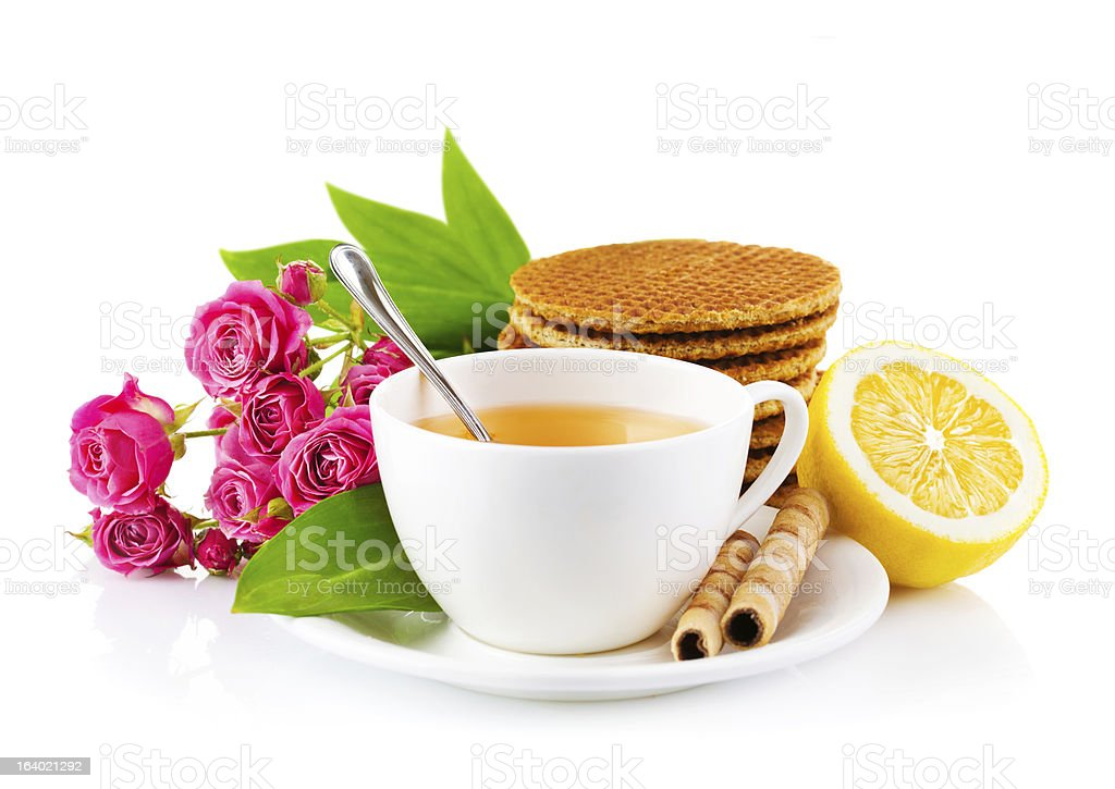 tea in cup with waffles and bouquet roses royalty-free stock photo