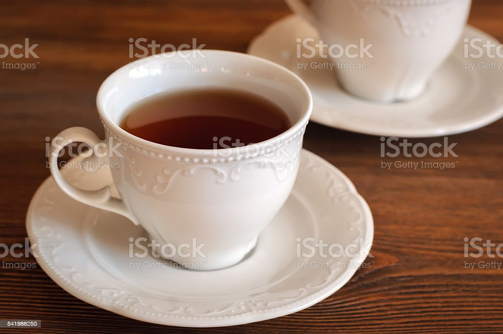 Tea in elegant teacup stock photo