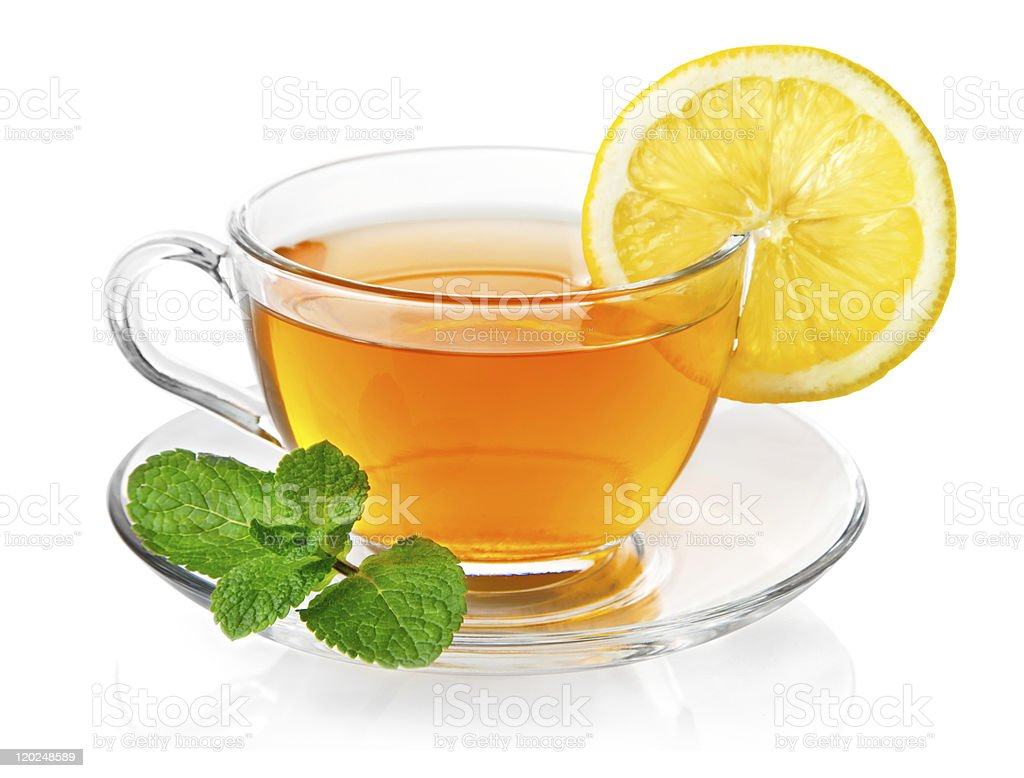 Tea in glass teacup with slice of lemon and mint garnish royalty-free stock photo