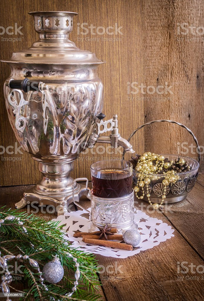 Tea in glass with coaster and russian samovar stock photo