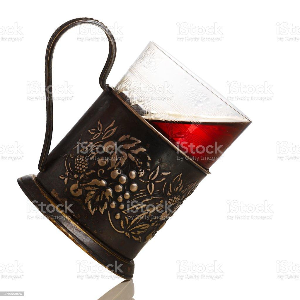Tea in glass-holder stock photo