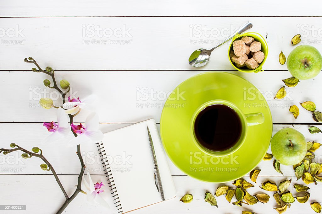 tea in green cup,  orchid flower.  top view stock photo