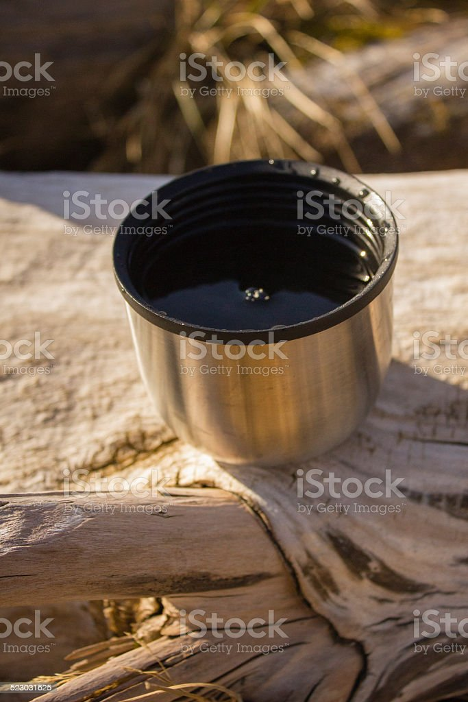 Tea in thermos mug stock photo