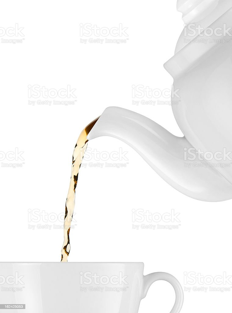 Tea is poured into the cup stock photo