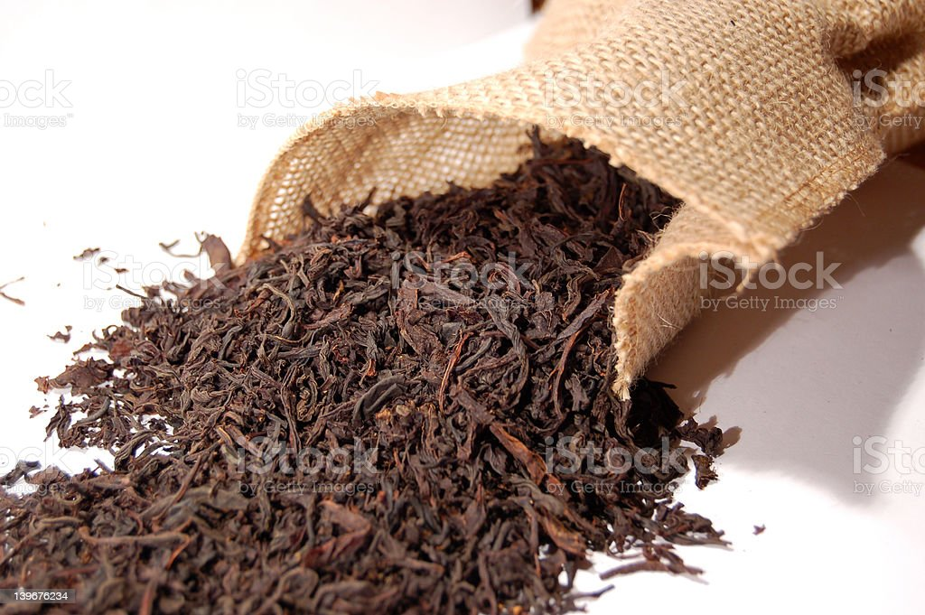 Tea leaves and canvas sack 5 royalty-free stock photo