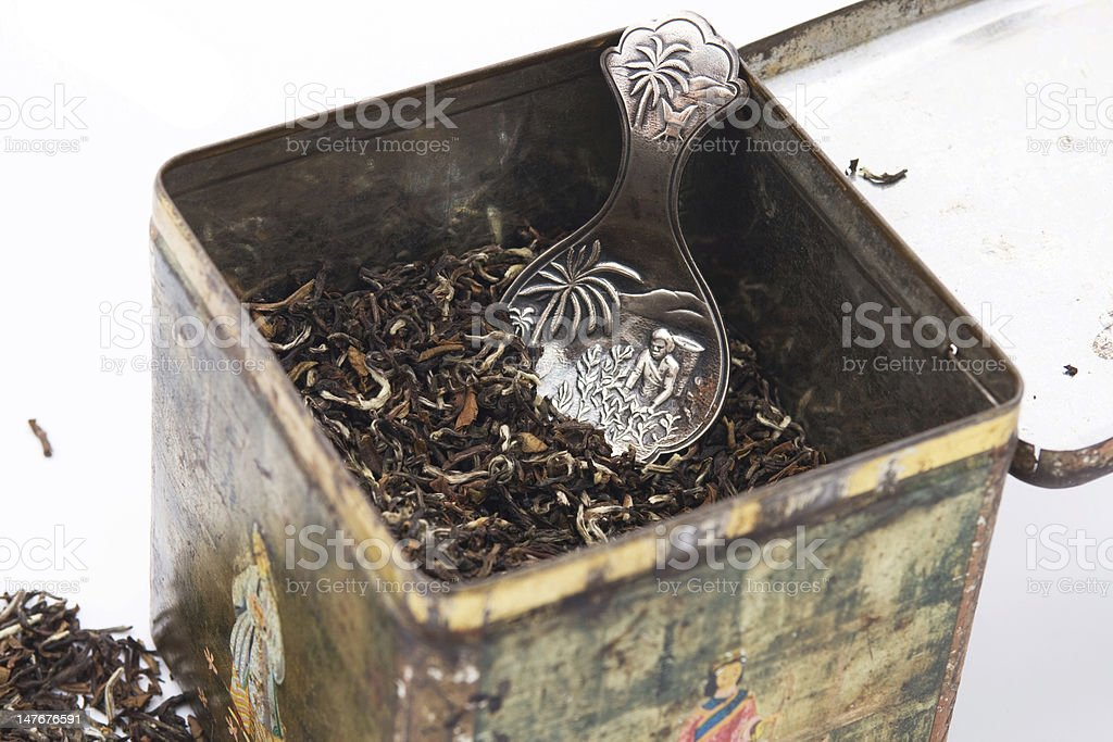 Tea leaves with antique silver teaspoon royalty-free stock photo